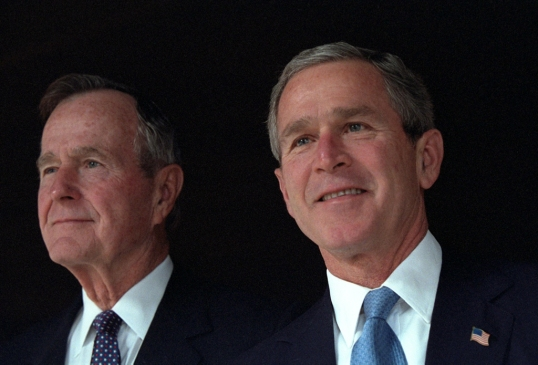 President George W. Bush poses with his father, former President George H. W. Bush, Sunday, Dec. 23, 2001, at Camp David in Thurmont, Maryland.  Photo by Eric Draper, Courtesy of the George W. Bush Presidential Library